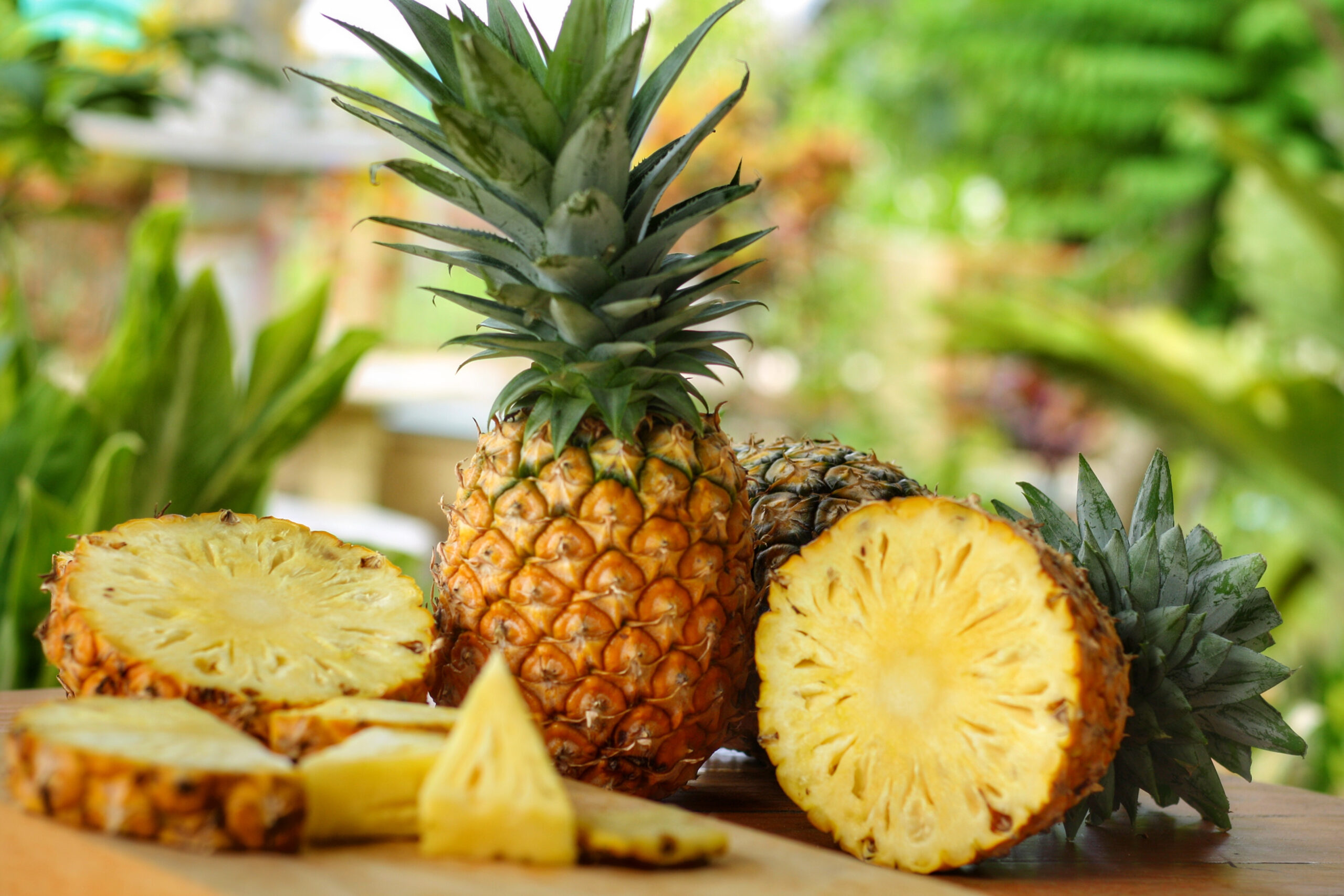 Whole,And,Pieces,Of,Pineapple(ananas,Comosus),On,Wooden,Table,With